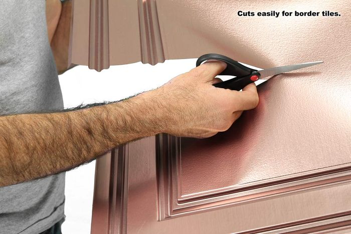 Cutting a Stratford tile with scissors
